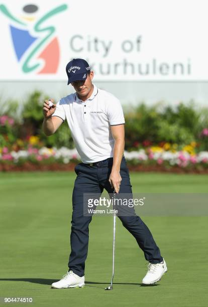 Chris Paisley of England acknowldges the crowd on the 18th green during the third round of the BMW South African Open Championship at Glendower Golf...