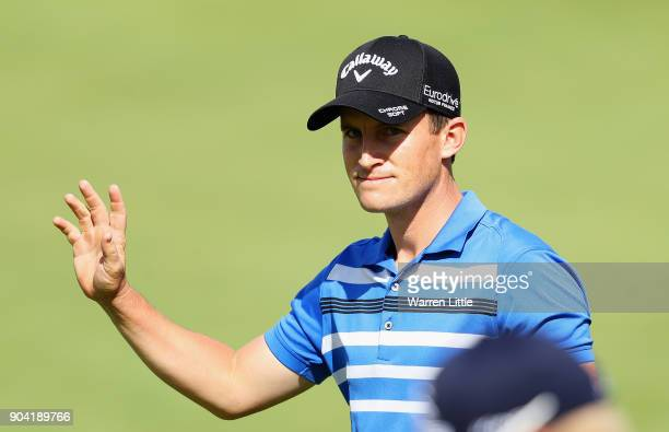 Chris Paisley of England acknowledges the crowd on the 18th green during day two of the BMW South African Open Championship at Glendower Golf Club on...