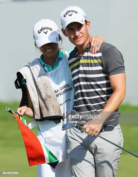 Chris Paisley of England celebrates victory with caddie and wife Keri on the 18th green during day four of the BMW South African Open Championship at...