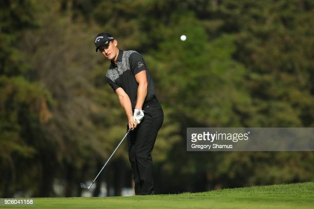 Chris Paisley of England chips to the 18th hole during the first round of World Golf ChampionshipsMexico Championship at Club de Golf Chapultepec on...