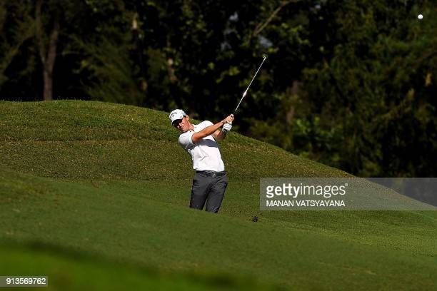Chris Paisley of England drives the ball on the 2nd fairway during the third round of the 2018 Maybank Malaysia Golf Championship at Saujana Golf and...