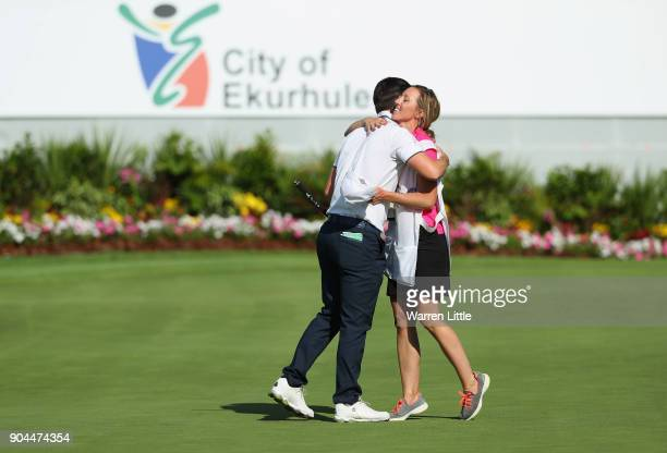 Chris Paisley of England hugs his caddie and wife Keri Paisley on the 18th green after finsihing his third round of the BMW South African Open...