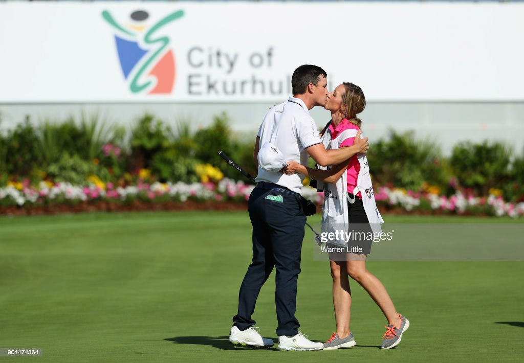 Chris Paisley of England hugs his caddie and wife Keri Paisley on the 18th green after finsihing his third round of the BMW South African Open Championship at Glendower Golf Club on January 13, 2018 in Johannesburg, South Africa.