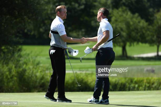Chris Paisley of England is congratulated on his victory by Nathan Kimsey of England on the 15th green during the 32 qualifiers matches of the...