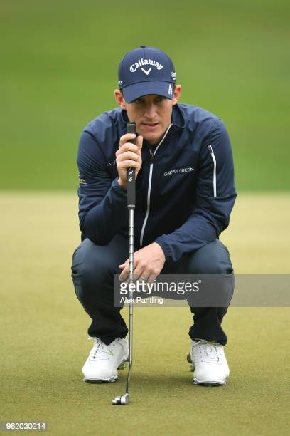 Chris Paisley of England lines up a putt on the 12th green during day one of the 2018 BMW PGA Championship at Wentworth on May 24 2018 in Virginia...