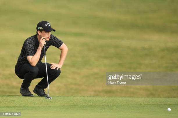 Chris Paisley of England lines up a putt on the eighteenth green during Day Four of the Portugal Masters at Dom Pedro Victoria Golf Course on October...