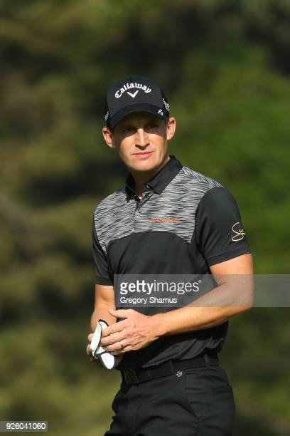 Chris Paisley of England looks on after his second shot on 18th hole during the first round of World Golf ChampionshipsMexico Championship at Club de...