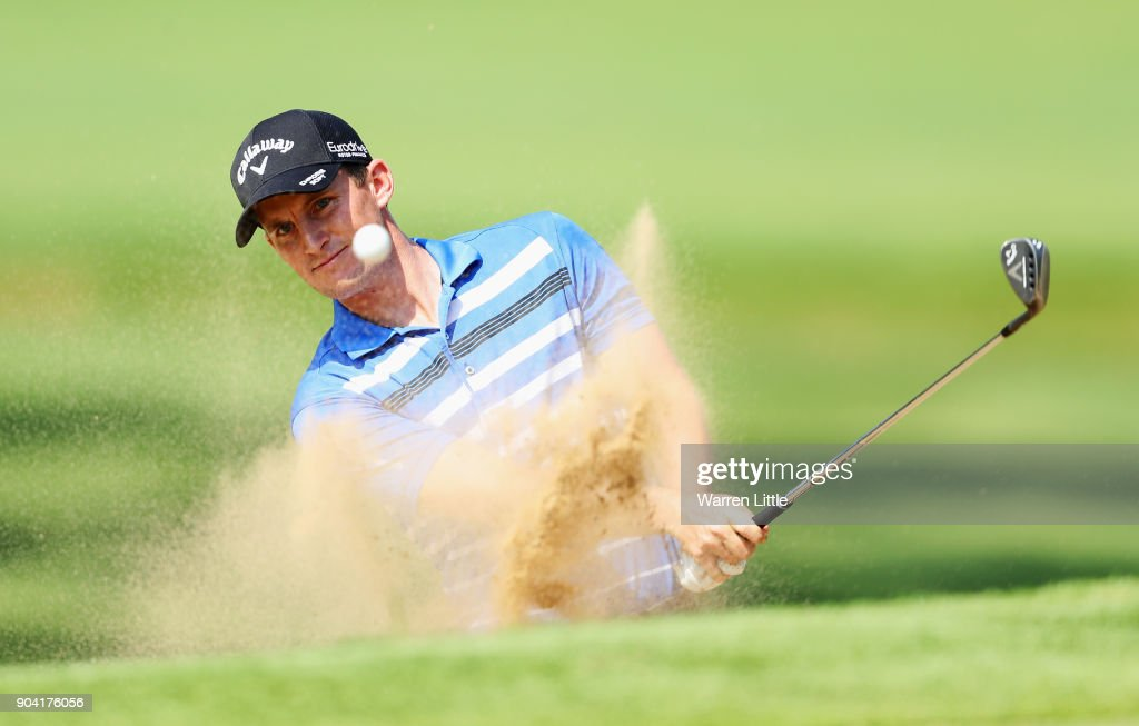 Chris Paisley of England plays from a bunker on the 15th hole during day two of the BMW South African Open Championship at Glendower Golf Club on January 12, 2018 in Johannesburg, South Africa.