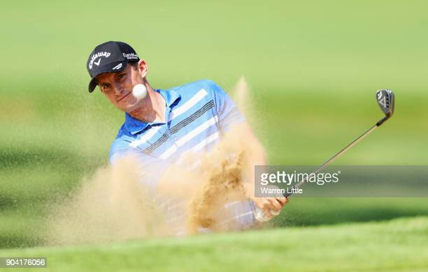 Chris Paisley of England plays from a bunker on the 15th hole during day two of the BMW South African Open Championship at Glendower Golf Club on...