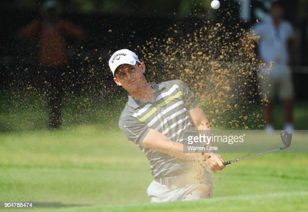 Chris Paisley of England plays from a bunker on the 15th hole during day four of the BMW South African Open Championship at Glendower Golf Club on...