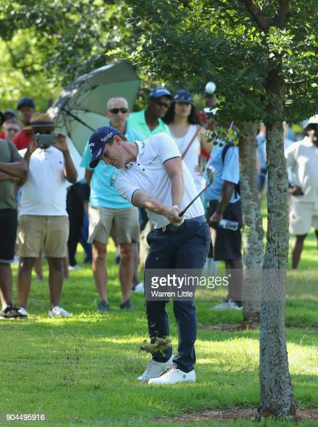 Chris Paisley of England plays his second shot into the 18th green during the third round of the BMW South African Open Championship at Glendower...