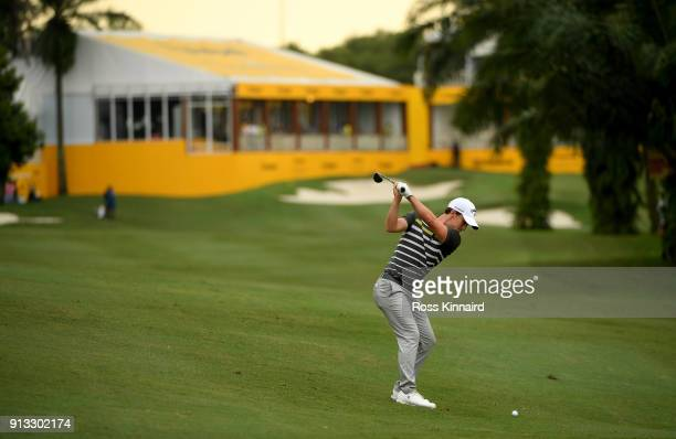 Chris Paisley of England plays his second shot into the par five 18th hole during the second round of the Maybank Championship Malaysia at Saujana...