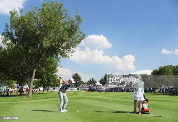 Chris Paisley of England plays his second shot on the 18th hole during day four of the BMW South African Open Championship at Glendower Golf Club on...