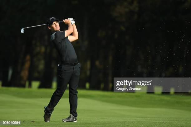 Chris Paisley of England plays his second shot on18th hole during the first round of World Golf ChampionshipsMexico Championship at Club de Golf...