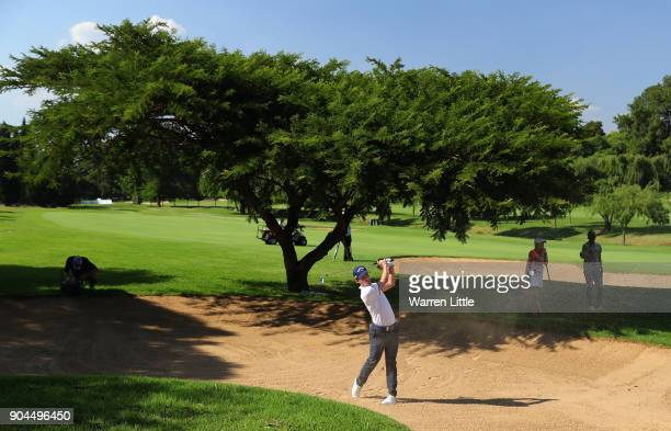 Chris Paisley of England plays out of the 15th fiarway bunker during the third round of the BMW South African Open Championship at Glendower Golf...