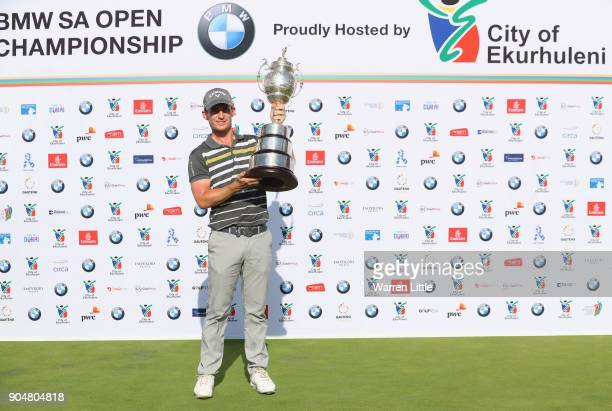 Chris Paisley of England poses with the trophy after his victory during day four of the BMW South African Open Championship at Glendower Golf Club on...