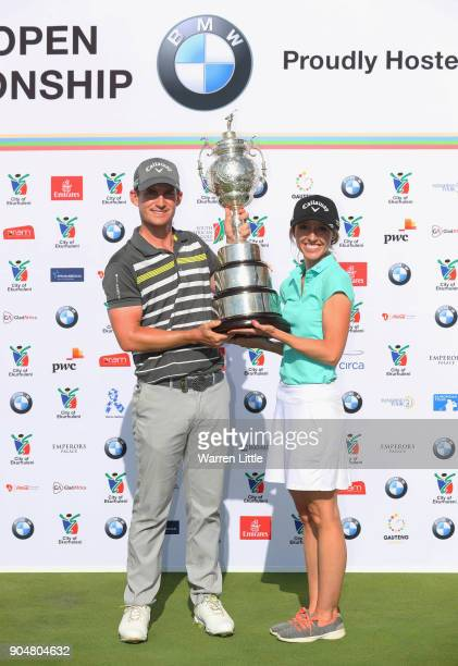 Chris Paisley of England poses with the trophy and caddie and wife Keri after his victory during day four of the BMW South African Open Championship...