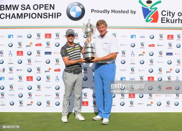 Chris Paisley of England poses with the trophy and Ernie Els of South Africa after his victory during day four of the BMW South African Open...