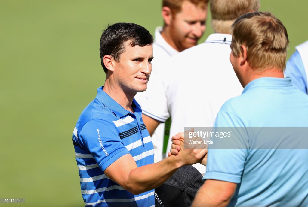 Chris Paisley (L) of England shakes hands with Ross McGowan of England on the 18th green during day two of the BMW South African Open Championship at Glendower Golf Club on January 12, 2018 in Johannesburg, South Africa.