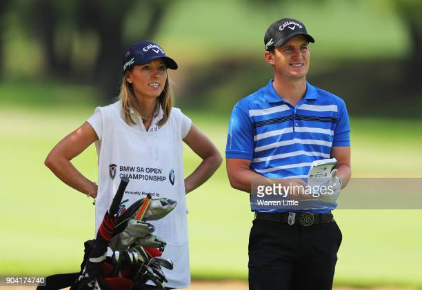 Chris Paisley of England talks with caddie and wife Keri on the 15th hole during day two of the BMW South African Open Championship at Glendower Golf...