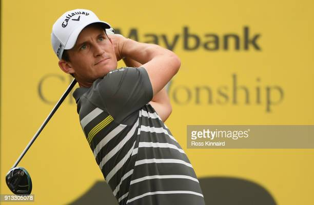 Chris Paisley of England watches his tee shot on the par five 18th hole during the second round of the Maybank Championship Malaysia at Saujana Golf...