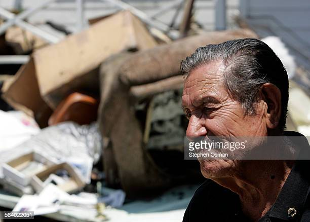 Chris Palomarez 79 in front of his fire damaged home with piles of burned furniture in background Illegal fireworks are believed to be the cause of a...