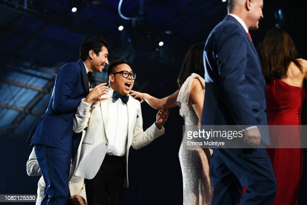 Chris Pang and Nico Santos walk onstage to accept Best Comedy for 'Crazy Rich Asians' at the 24th annual Critics' Choice Awards at Barker Hangar on...