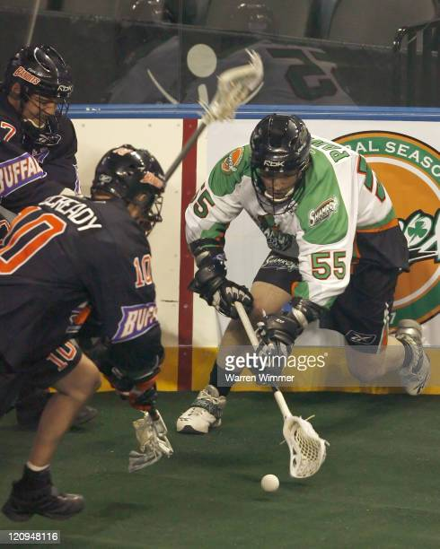 Chris Panos of the Shamrox battles along the boards for ball possession during game action at the Sears Centre Hoffman Estates IL where the Buffalo...