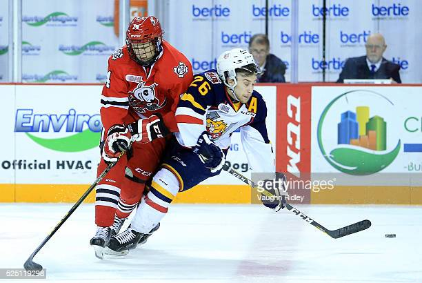 Chris Paquette of the Niagara IceDogs checks Andrew Mangiapane of the Barrie Colts during the first period in Game Four of the 2016 OHL Eastern...