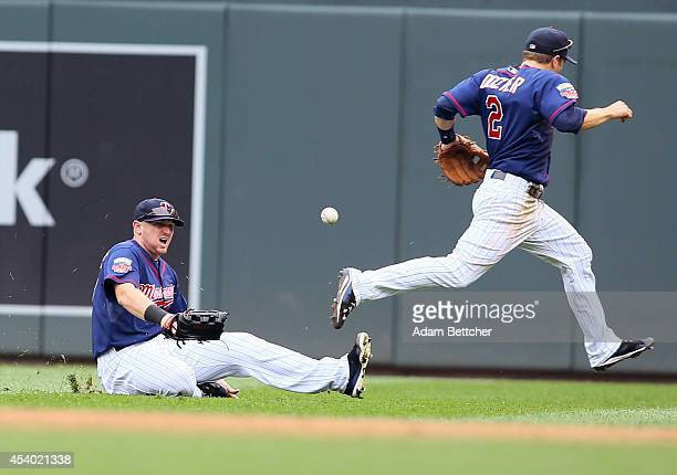 Chris Parmelee and Brian Dozier of the Minnesota Twins misses the catch of a Ian Kinsler of the Detroit Tigers single in the fifth inning at Target...