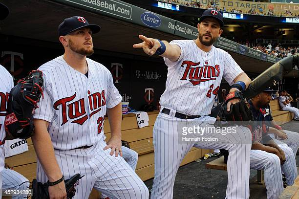 Chris Parmelee and Trevor Plouffe of the Minnesota Twins look on before the game against the Cleveland Indians on July 21, 2014 at Target Field in...