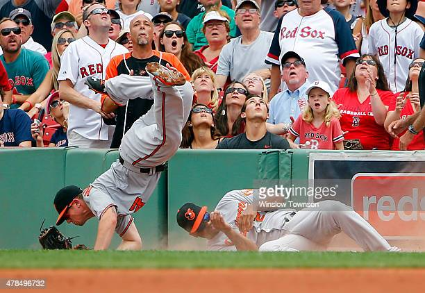 Chris Parmelee of the Baltimore Orioles and Delmon Young of the Baltimore Orioles collide going for a double by Mike Napoli of the Boston Red Sox...