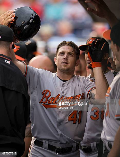 Chris Parmelee of the Baltimore Orioles high fives his teammates after he hit a solo home run in the top of the first inning against the Philadelphia...