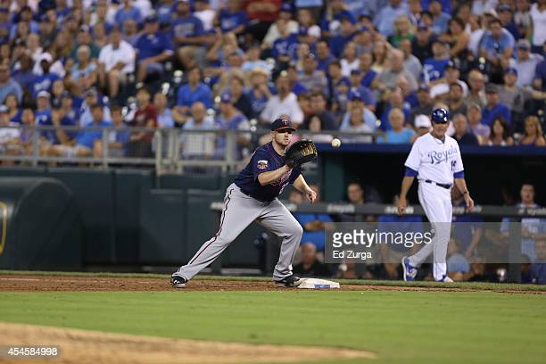 Chris Parmelee of the Minnesota Twins catches a ball as he gets the force out against the Kansas City Royals at Kauffman Stadium on August 28, 2014...
