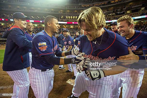 Chris Parmelee of the Minnesota Twins celebrates his walk-off home run with teammates against the Boston Red Sox on May 13, 2014 at Target Field in...