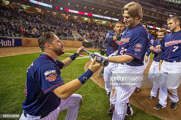 Chris Parmelee of the Minnesota Twins celebrates his walk-off home run with teammate Trevor Plouffe against the Boston Red Sox on May 13, 2014 at...