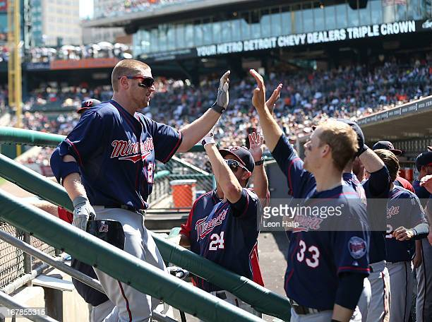 Chris Parmelee of the Minnesota Twins celebrates with his teammates after hititing a solo home run to right field in the eighth inning of the game...