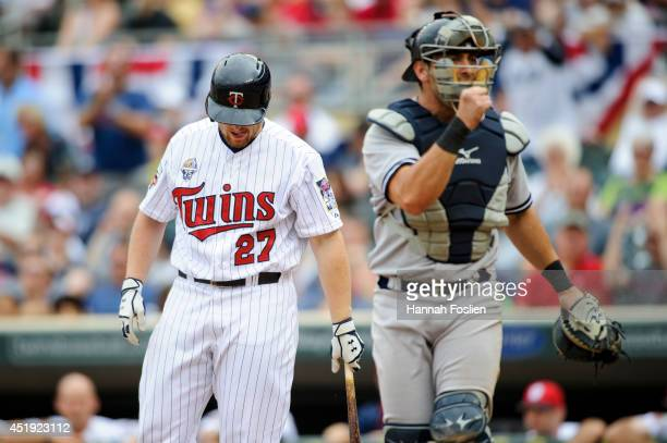 Chris Parmelee of the Minnesota Twins eracts to striking out as Francisco Cervelli of the New York Yankees celebrates a win of the game on July 4,...