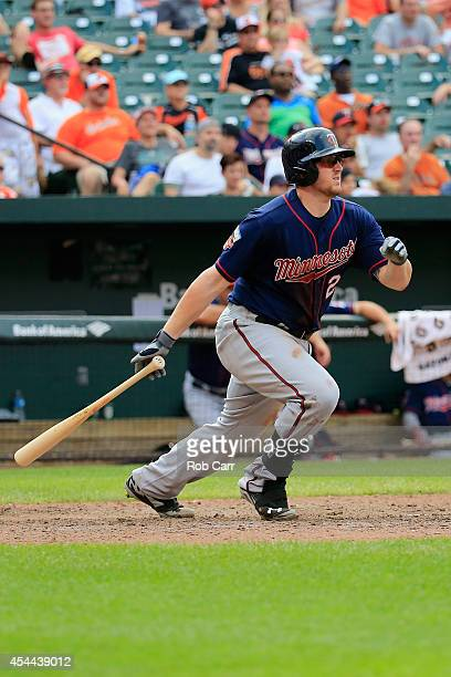 Chris Parmelee of the Minnesota Twins follows his two RBI single against the Baltimore Orioles during the ninth inning of the Twins 12-8 loss at...