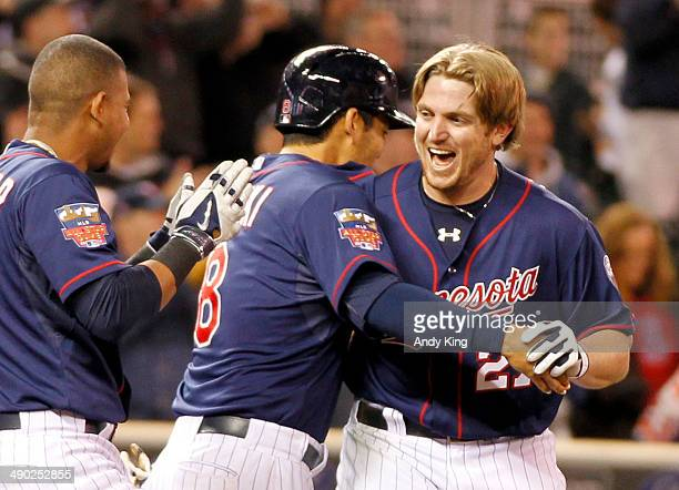 Chris Parmelee of the Minnesota Twins is congratulated by teammates after his walk off two-run home run in the ninth inning to beat the Boston Red...