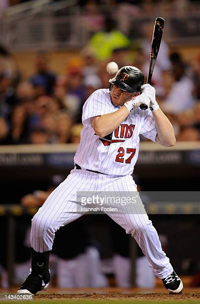 Chris Parmelee of the Minnesota Twins is hit on the helmet by a pitch thrown by Justin Thomas of the Boston Red Sox during the sixth inning on April...
