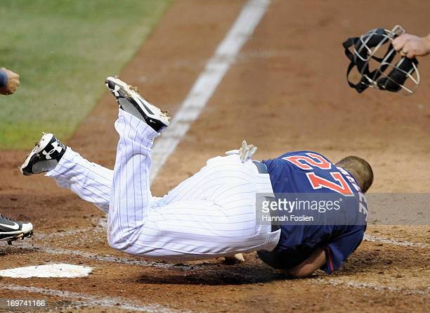 Chris Parmelee of the Minnesota Twins is out at home plate after a collision with Jesus Sucre of the Seattle Mariners during the third inning of the...
