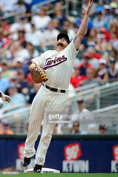 Chris Parmelee of the Minnesota Twins makes a play at first base during the game against the Cleveland Indians on July 23, 2014 at Target Field in...