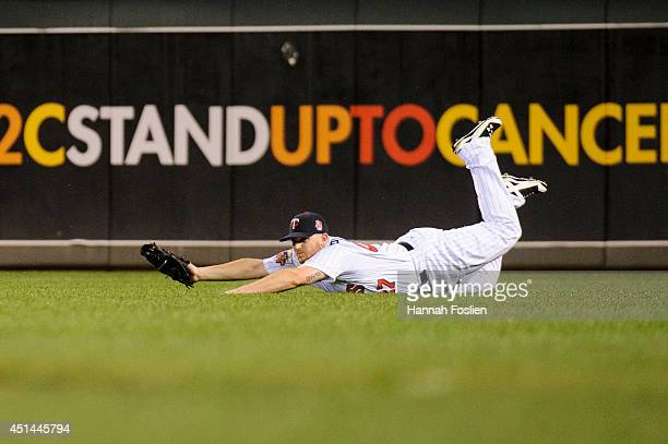 Chris Parmelee of the Minnesota Twins makes a play in right field during the game against the Chicago White Sox on June 19, 2014 at Target Field in...