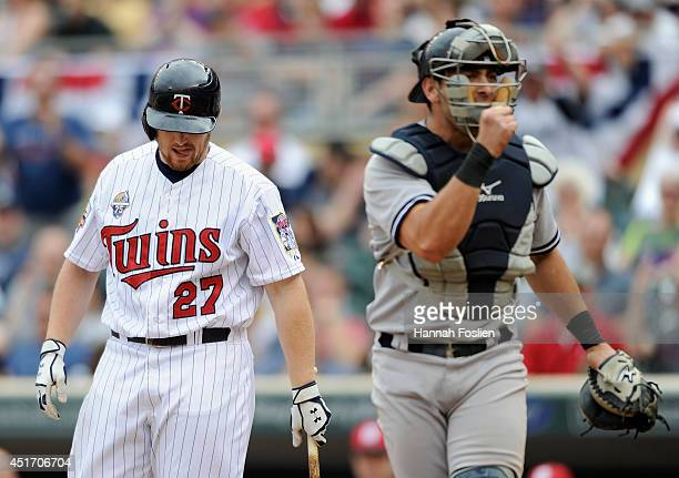 Chris Parmelee of the Minnesota Twins reacts to striking out to end the game as Francisco Cervelli of the New York Yankees celebrates the win on July...