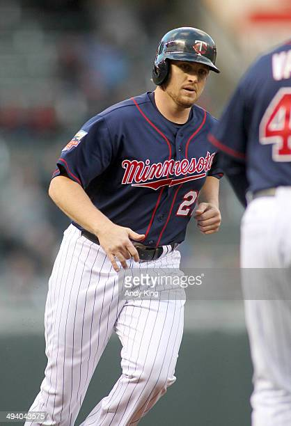 Chris Parmelee of the Minnesota Twins rounds the bases after a home run by teammate Eduardo Nunez of the Minnesota Twins second inning against the...