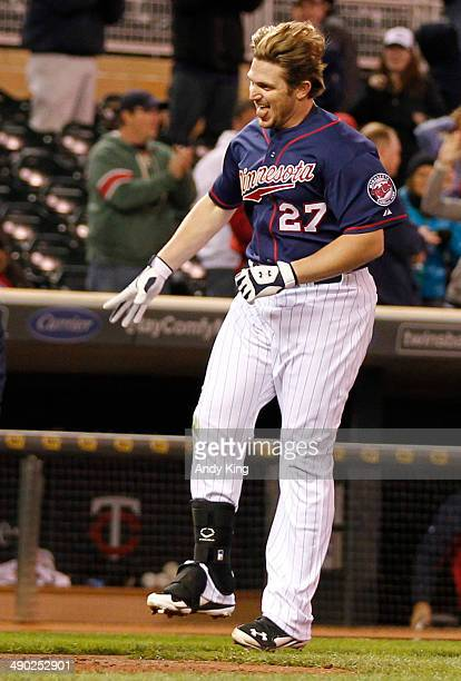 Chris Parmelee of the Minnesota Twins runs to home base after his walk off two-run home run in the ninth inning to beat the Boston Red Sox 8-6 during...