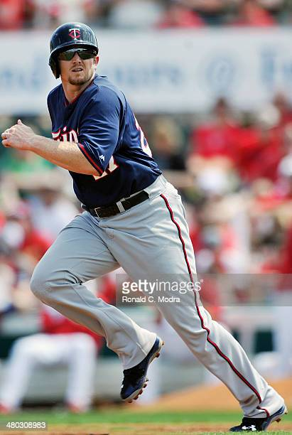 Chris Parmelee of the Minnesota Twins runs to second base during a spring training game against the St. Louis Cardinals at Roger Dean Stadium on...