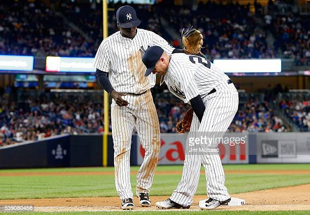 Chris Parmelee of the New York Yankees grimaces after an injury on the final out of the seventh inning against the Los Angeles Angels of Anaheim as...