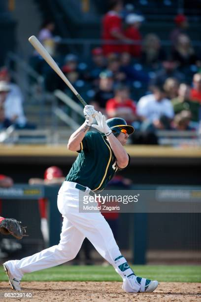 Chris Parmelee of the Oakland Athletics bats during the game against the Los Angeles Angels of Anaheim at Hohokam Stadium on February 26, 2017 in...